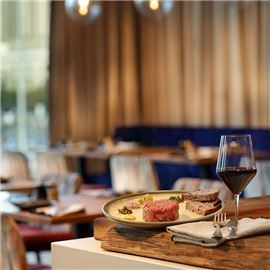 Classic french steak tartar with wine at Floor No 2 Restaurant